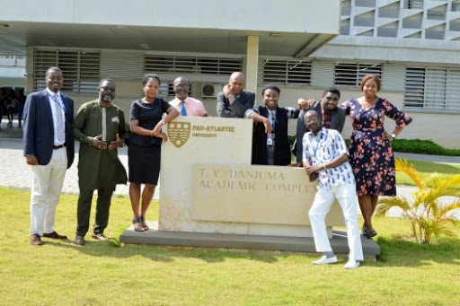 Students of the Lekki, Lagos based Pan-Atlantic University are seen here round a signage logo of the Institution in this photo by Edusko, Via Google,. The Institution is among the universities in Lagos and Ogun State